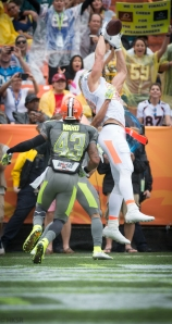 Jimmy Graham grabs a completion over T.J. Ward-  Hakim Wright/TPR®