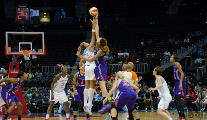 Tip off to the game. Atlanta's Erika De Souza and Phoenix's Brittany Griner (Photo: Hakim Wright)