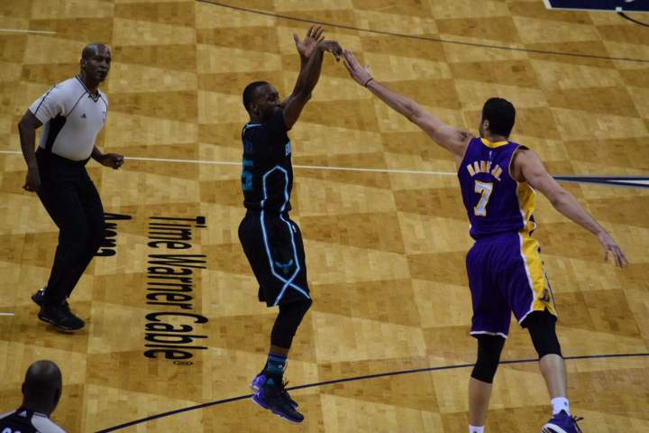Hornets Guard Kemba Walker pulls up for two. Walker scored 38 points to lead the Hornets past the Lakers. (Tony Stanford Jr.)