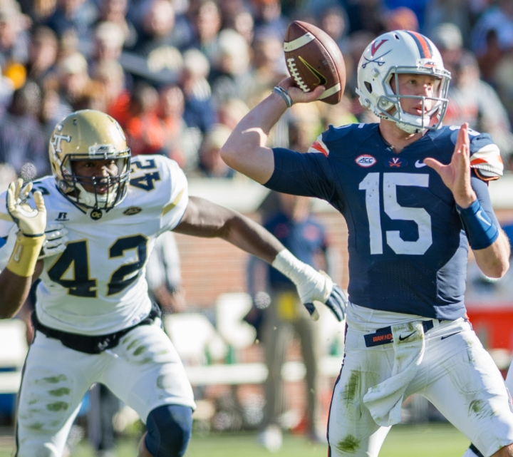 Georgia Tech's defense kept the pressure on Virginia Quarterback Matt Johns after forcing 3 interceptions for the day (Hakim Wright).