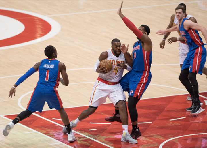 Paul Millsap drives hard to the hoop against the Pistons (Hakim Wright)