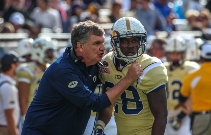 Georgia Tech coach Paul Johnson discussing changes with A-Back J.J. Green. (X)