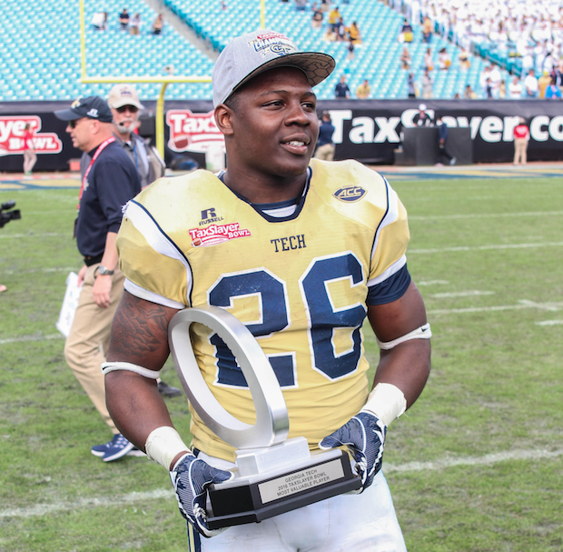 Georgia Tech Running Back Dedrick Mills is awarded the MVP trophy at the 2016 Tax Slayer Bowl (X)