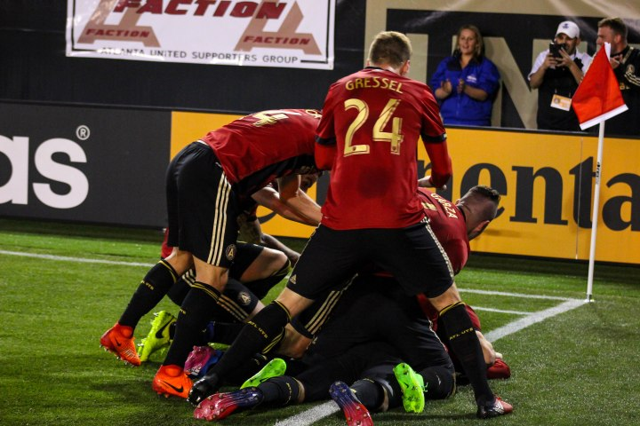 Players celebrate and surround Yamil Asad after scoring the first goal in the club's history (X).